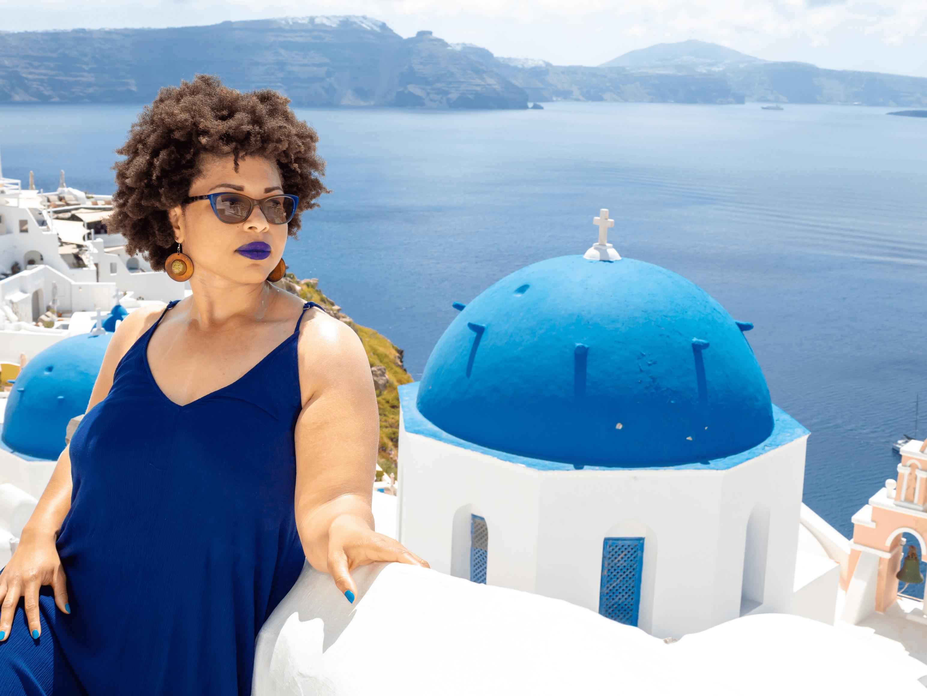 Adriana standing in Santorini, Greece