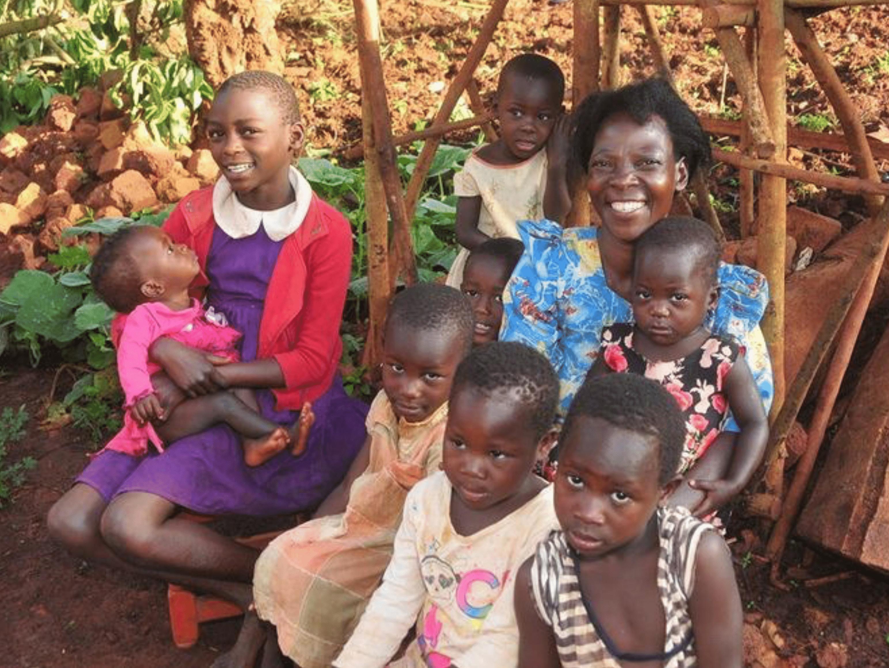 Ugandan women and girls smiling at Camera